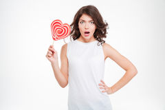 Amazed woman holding lollipop Royalty Free Stock Photos