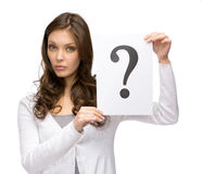 Amazed woman holding question mark Stock Photo