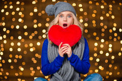 Amazed woman holding red heart Stock Images