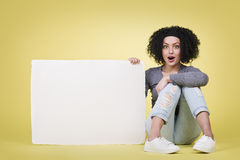 Amazed woman holding a white sign board Royalty Free Stock Images
