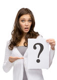 Amazed woman keeping question mark Stock Photos