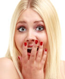 Amazed woman looking at camera Royalty Free Stock Photography