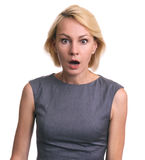 Amazed woman looking at camera. Isolated on a white background Royalty Free Stock Photo