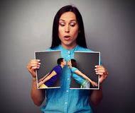 Amazed woman looking at disrupt photo Stock Photo