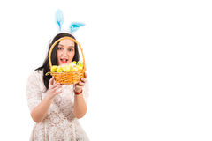 Amazed woman looking in Easter basket Royalty Free Stock Images