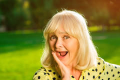 Amazed woman with open mouth. Royalty Free Stock Photography
