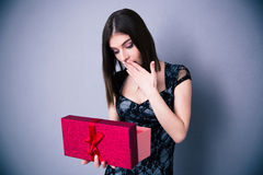 Amazed woman opening gift box Stock Images