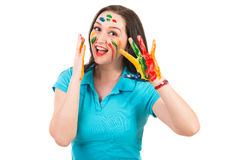 Amazed woman with paints on face and hands Royalty Free Stock Images