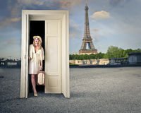 Amazed woman in Paris. Fashion woman arriving in Paris through a door royalty free stock image