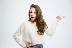 Amazed woman pointing finger away Royalty Free Stock Images