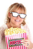 Amazed woman with popcorn and 3D glasses Stock Photography