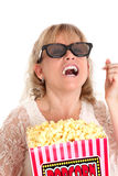 Amazed woman with popcorn and 3D glasses Royalty Free Stock Image