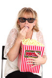 Amazed woman with popcorn and 3D glasses Royalty Free Stock Photos