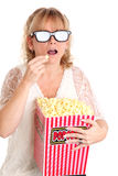 Amazed woman with popcorn and 3D glasses Stock Images