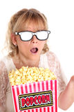 Amazed woman with popcorn and 3D glasses Royalty Free Stock Images