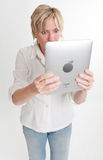 Amazed woman reading from a PC tablet Royalty Free Stock Photography