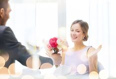 Amazed woman recieving bouquet of flowers Stock Photography