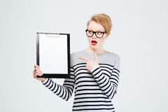 Amazed woman showing blank clipboard royalty free stock images