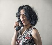 Amazed woman speaking on the phone. An Amazed woman speaking on the phone Royalty Free Stock Images