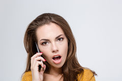 Amazed woman talking on the phone Royalty Free Stock Photos