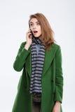Amazed woman talking on the phone Royalty Free Stock Photo