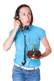 Amazed woman talking in the retro phone Stock Image