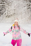 Amazed woman throw snow. Amazed laughing woman throwing snow and having fun Stock Photo
