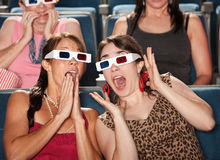 Amazed Women Watch 3d Movie Royalty Free Stock Photography