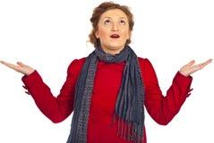 Amazed and wonder woman looking up. Amazed woman in red jacket looking up and wondering isolated on white background Stock Photos
