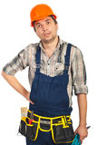 Amazed workman looking up. Isolated on white background Stock Photos