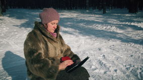 Amazed wow woman looking a tablet application in a snowy mountain on vacations. Amazed wow woman looking  tablet application in a snowy mountain on vacations stock video footage