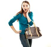 Amazed youn woman. Young amazed woman wearing blue sweater Stock Photos