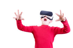 Amazed young child in virtual reality headset. Amazed young child wearing red shirt experiencing a shocking explosion while wearing a virtual reality headset stock photos
