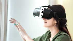 Amazed young European woman wearing vr mask glasses making gesture turning page by hands. Medium close-up amazed young European woman wearing vr mask glasses stock video