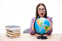 Amazed young female student looking at globe Stock Photography