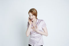Amazed Young Female Using Cell Phone Royalty Free Stock Images