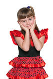 Amazed young girl in a red polka dot dress. A portrait of an amazed young girl in a red polka dot dress on the white background Stock Photos