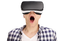 Amazed young guy using a VR headset Stock Photography