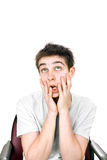 Amazed young man. Funny and amazed young man isolated on the white background Stock Images