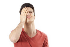 Amazed young man hand holding head. On white Royalty Free Stock Image
