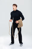 Amazed young man with rope standing and looking up Stock Photo