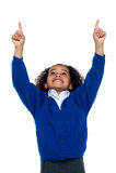 Amazed young school girl indicating upwards. Amazed young cheerful school girl looking and indicating upwards Royalty Free Stock Images