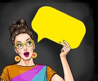 Amazed young sexy woman with open mouth looking up on empty yellow bubble.Thinking pop art girl stock photo