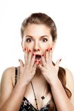 Amazed young woman. Amazed girl with widely open eyes and mouth Stock Image