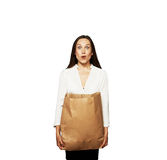 Amazed young woman with bag. Amazed young woman holding paper bag. isolated on white background Royalty Free Stock Photo