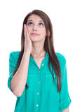 Amazed young woman in green blouse isolated on white. Royalty Free Stock Photography