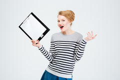 Amazed young woman holding clipboard Stock Images