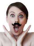 Amazed young woman with moustache; isolated. Young woman isolated on white; with moustache, amazed, surprized Stock Photo