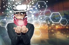 Amazed young women wearing virtual reality goggles. Amazed young woman wearing virtual reality goggles over abstract double exposure background Stock Image