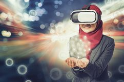 Amazed young women wearing virtual reality goggle for communication concept. Image of amazed young woman wearing virtual reality goggle for communication concept royalty free stock image